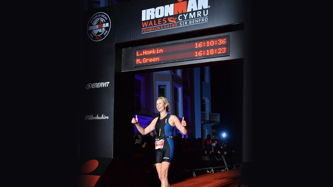 Lorna Hopkin celebrates after crossing the finish line in one of her Ironman races