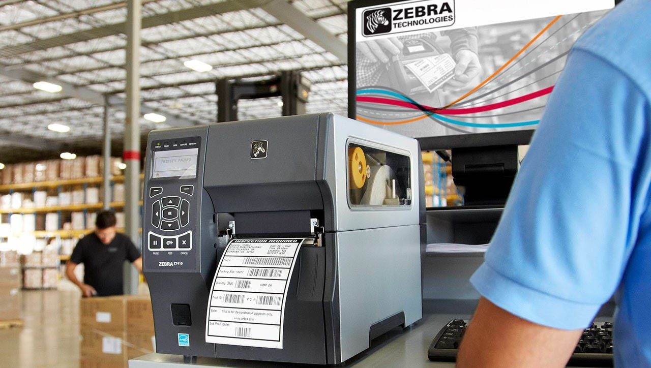 A Zebra industrial printer is used to print a label in a warehouse