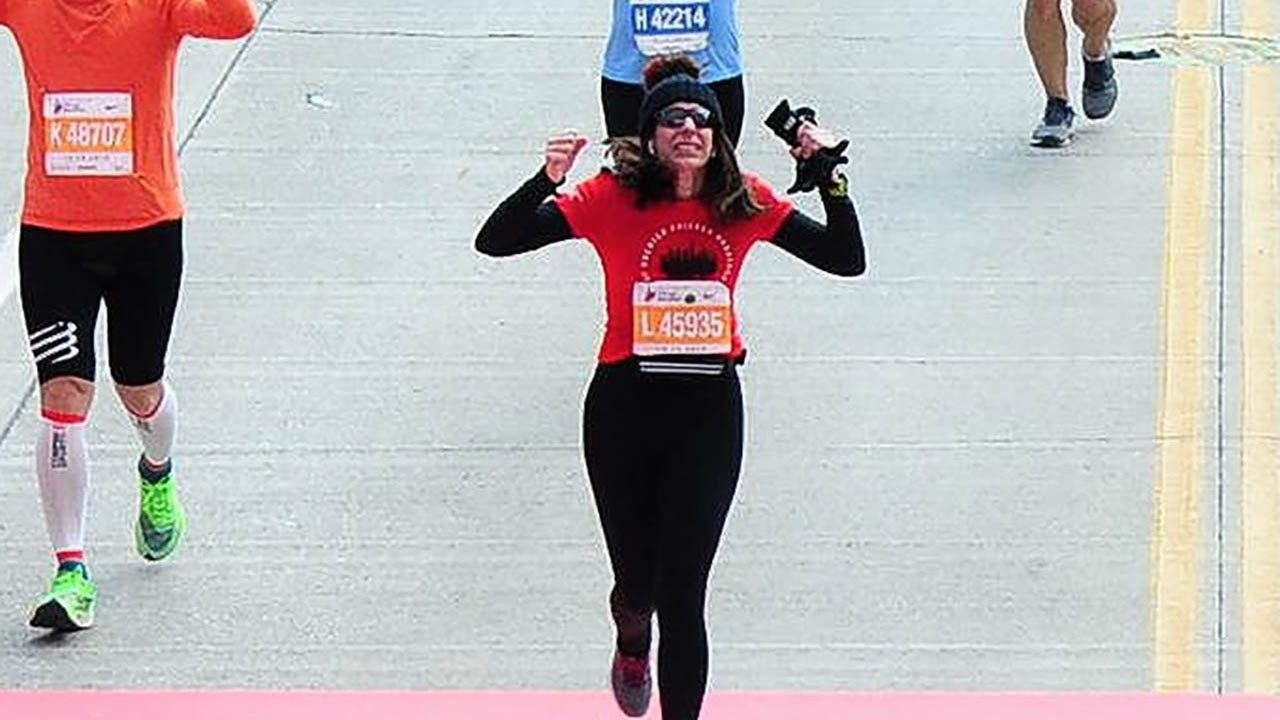 Lisa Cowgill crosses the finish line at a recent Chicago Marathon