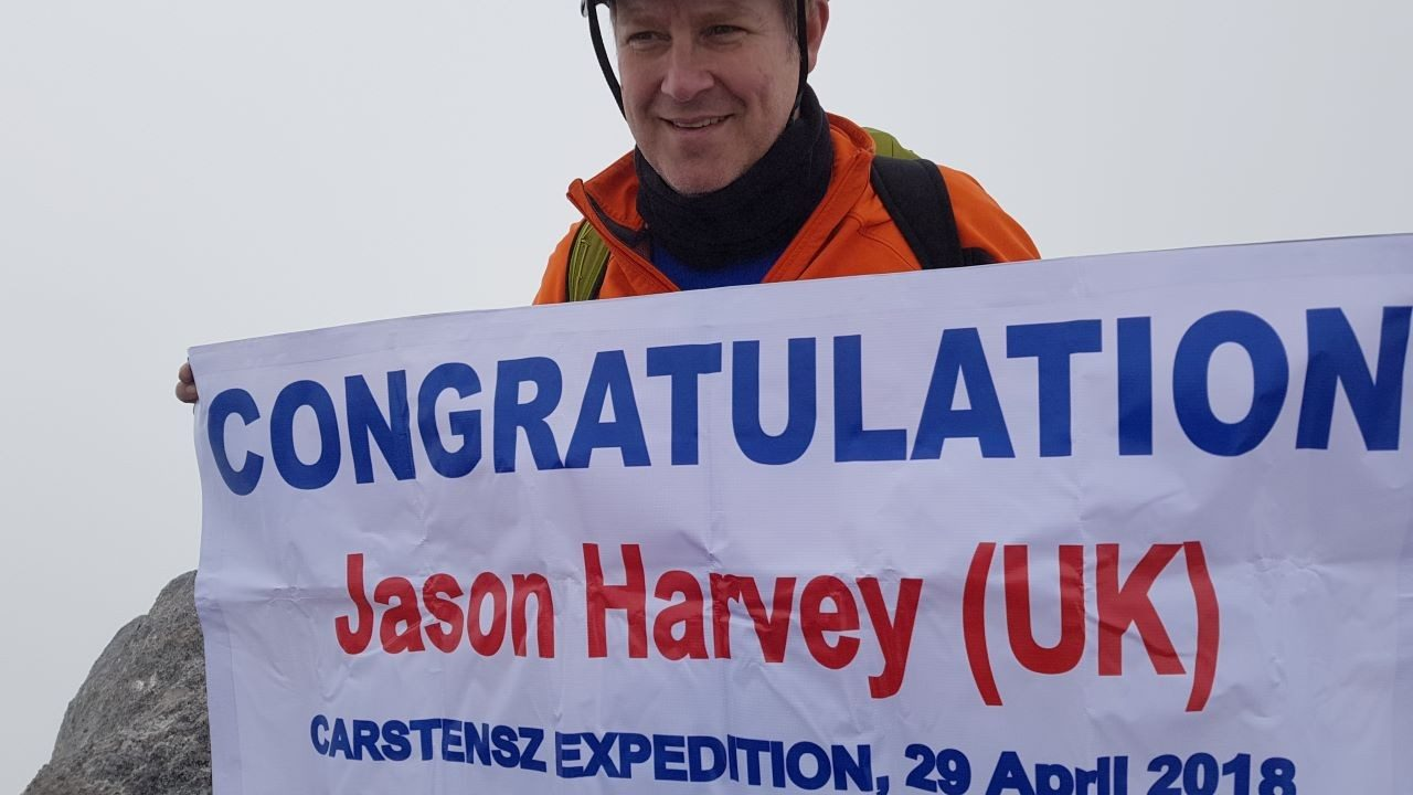 Zebra`s Jason Harvey celebrates the completion of the Carstensz summit