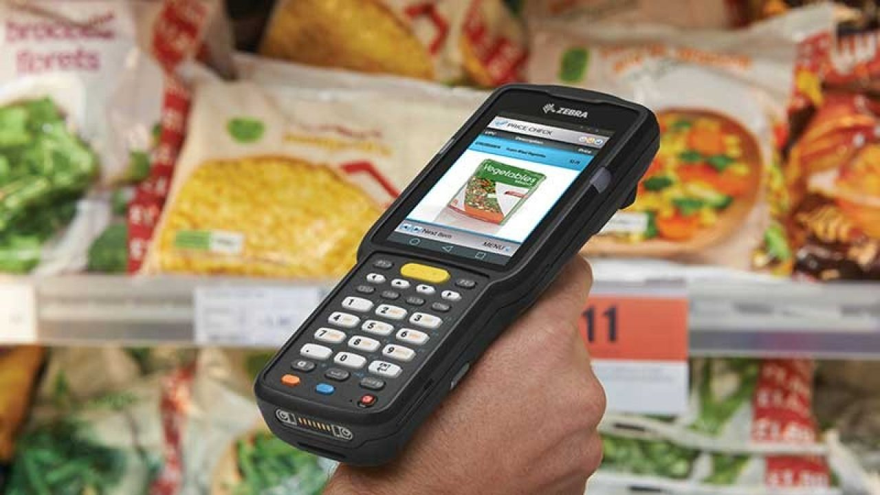 Mobile computer being used to scan items in a grocery store