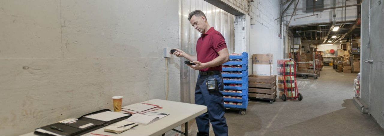 Man in warehouse using Zebra DX30