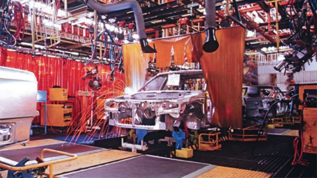 Car being assembled on Ford Motor Company`s assembly line