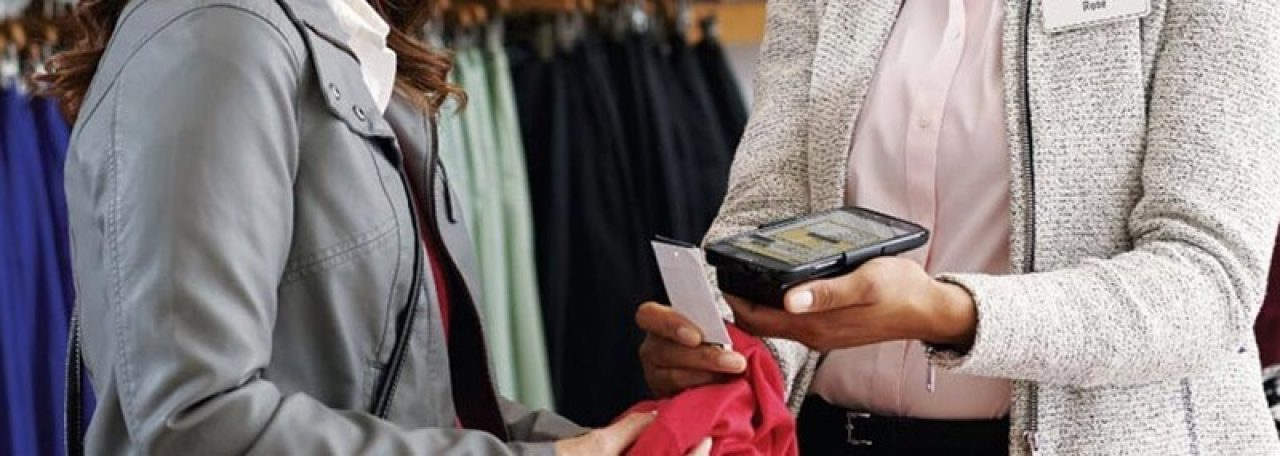 Shop worker scanning tag with mobile device