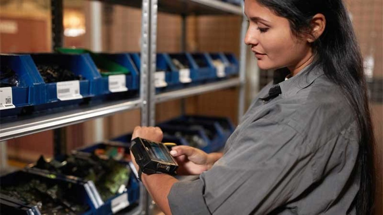 Woman with Zebra wearable devices finding stock in a warehouse