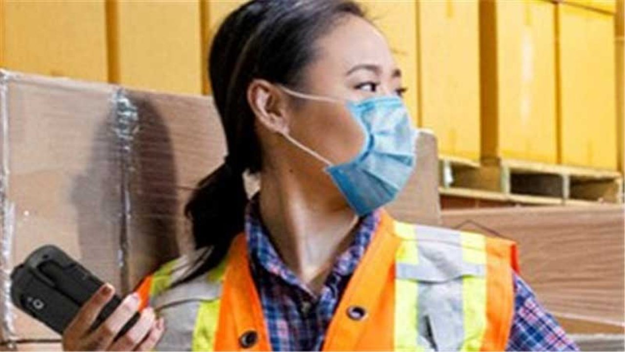Warehouse employee wearing a face mask.