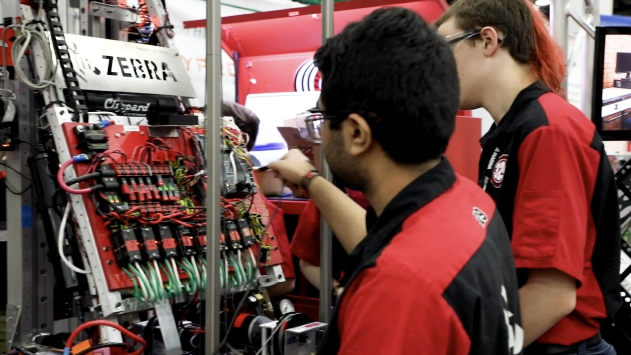 Students use Zebra technologies during a FIRST Robotics competition