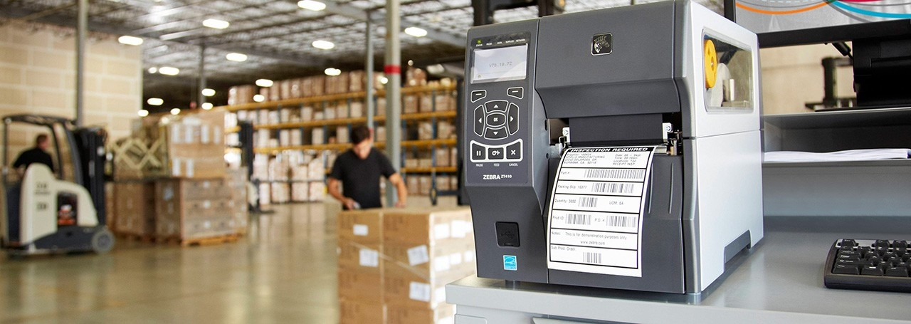 Zebra printer on a desk in a warehouse