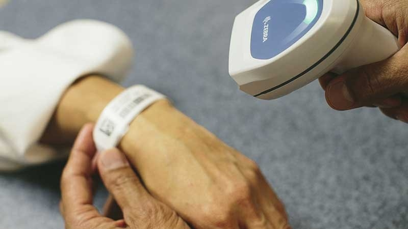 healthcare provider scanning patient wristband using a zebra scanner