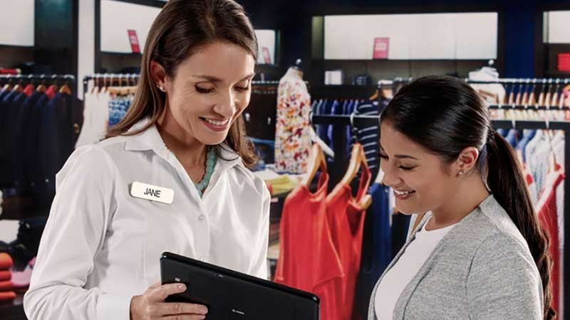 Retail employee using Zebra tablet to help customer.