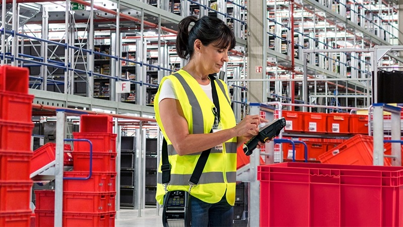 woman in warehouse managing inventory returns