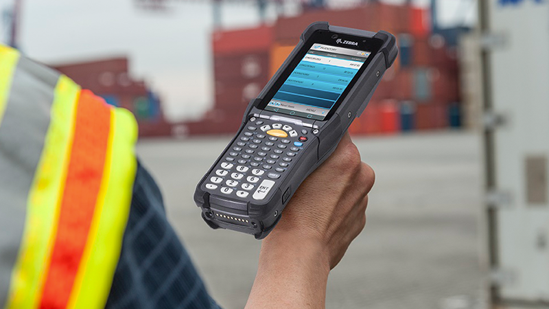 The new Zebra MC9300 mobile computer is used by a worker on a loading dock.