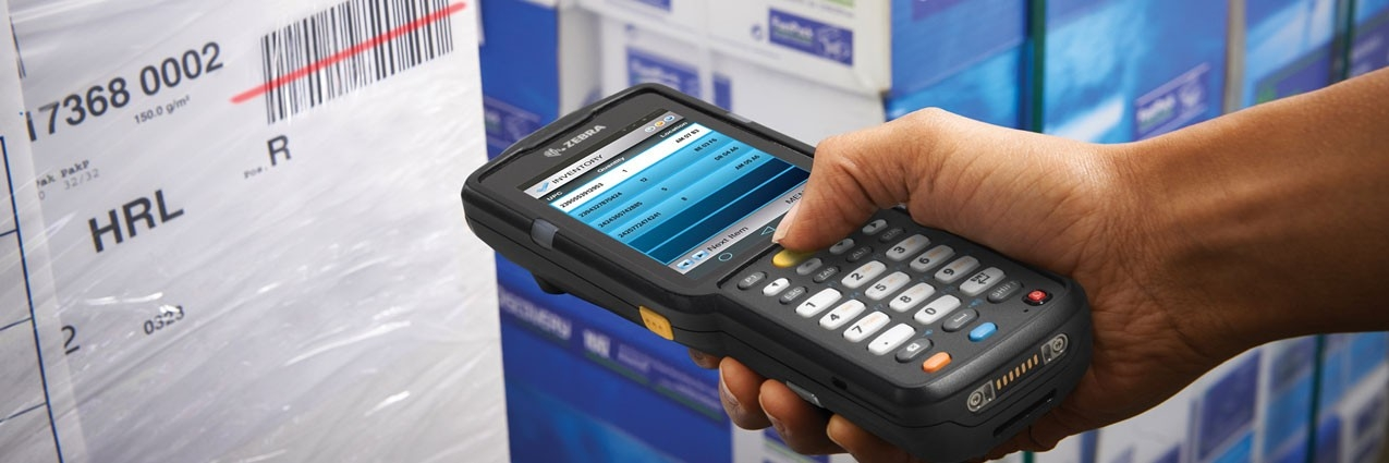 Person scanning a barcode with a Zebra MC3300 mobile computer with All\u002Dtouch Terminal Emulation installed
