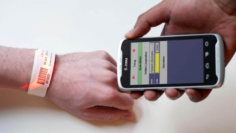 zebra mobile computer scanning a patient wristband barcode