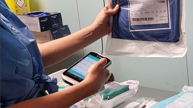 healthcare worker scanning medical package delivery