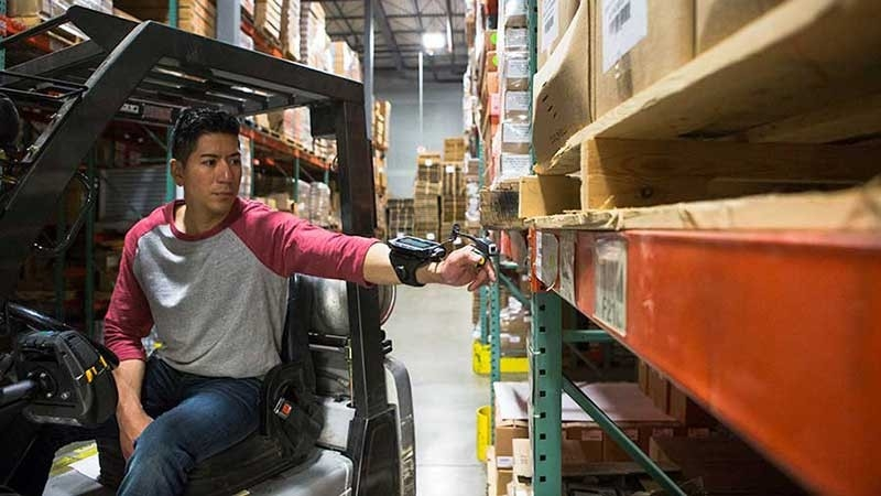 Man Using Ring Scanner in Warehouse