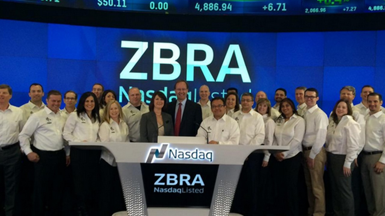 Zebra employees gather before the Nasdaq opening bell ceremony on April 16, 2015, during which time Zebra\x26#39;s new logo (the one still used today) was revealed.