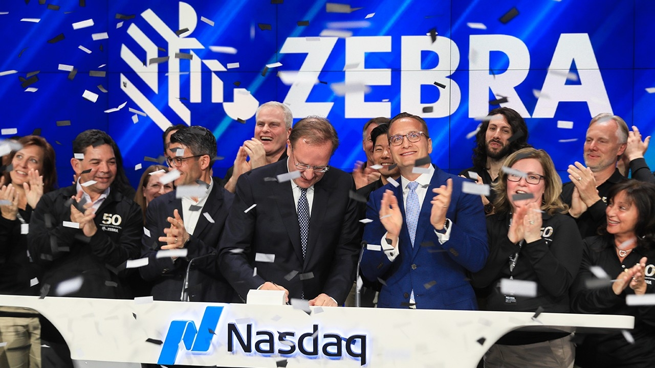 Zebra rings the Nasdaq closing market bell on May 1 at Times Square in New York City in celebration of the company's 50th anniversary. Photography by Libby Greene\/Nasdaq, Inc.