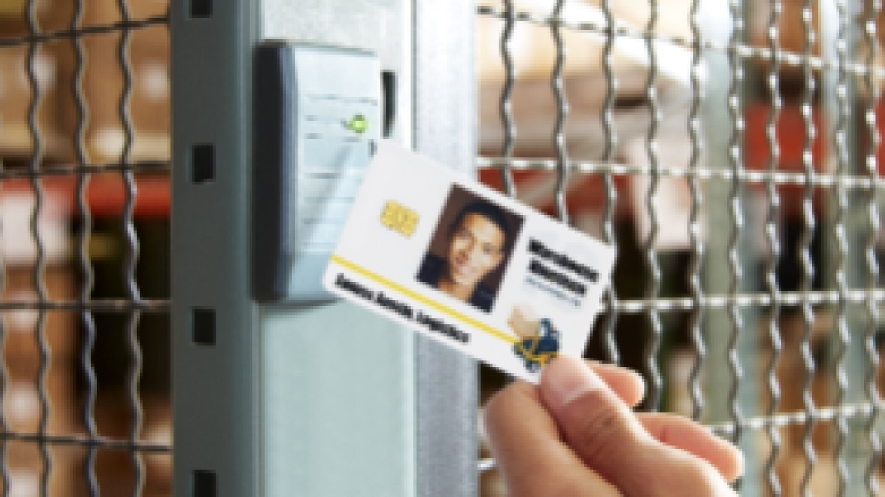An access card is scanned to gain entry to a secure section of a warehouse.