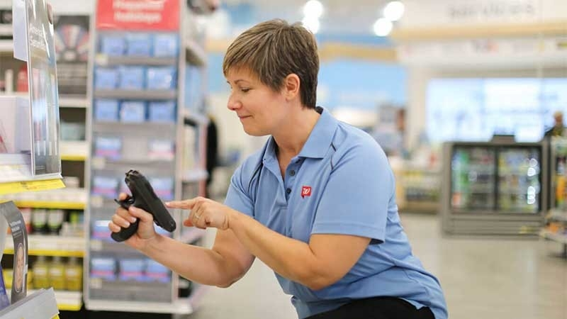 Walgreens worker using Zebra mobile device in store