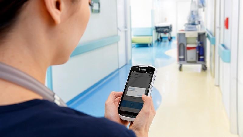 mobile nurse scanning a patient