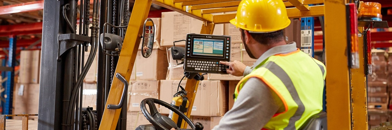 Man Working in Warehouse Using Zebra Mobile Device