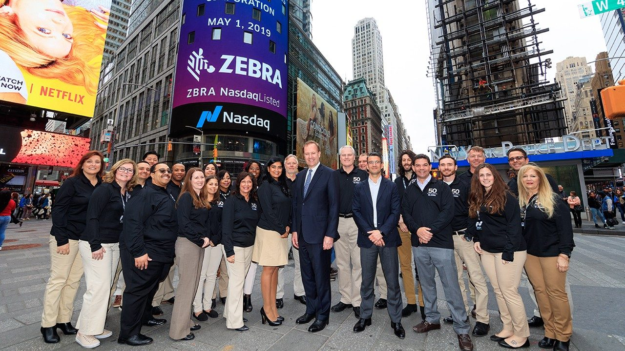 The Zebra team stands in Times Square ahead of the Nasdaq closing bell ceremony on May 1, 2019. Photography by Libby Greene\/Nasdaq, Inc.