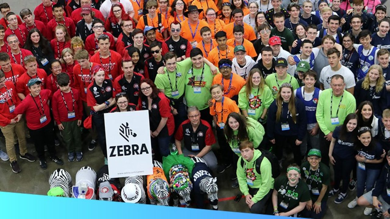 A group picture of Zebra\u002Dmentored FIRST Robotics teams