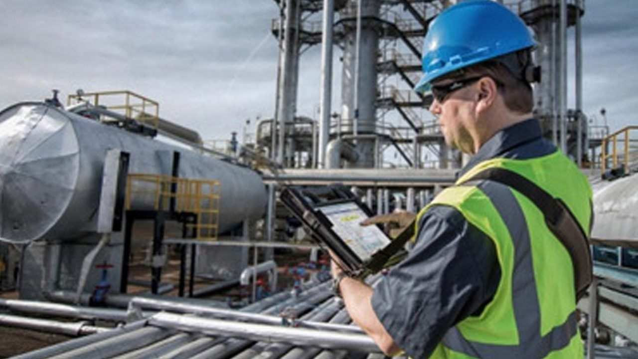 An energy worker uses a HazLoc\u002Dcertified rugged tablet to inspect equipment