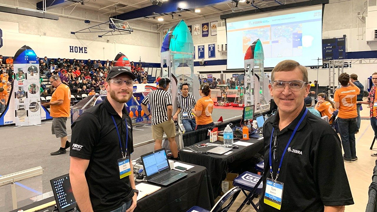 Zebra employees and FIRST Robotics mentors Matt Boehm and Tom Boehm at an off\u002Dseason competition