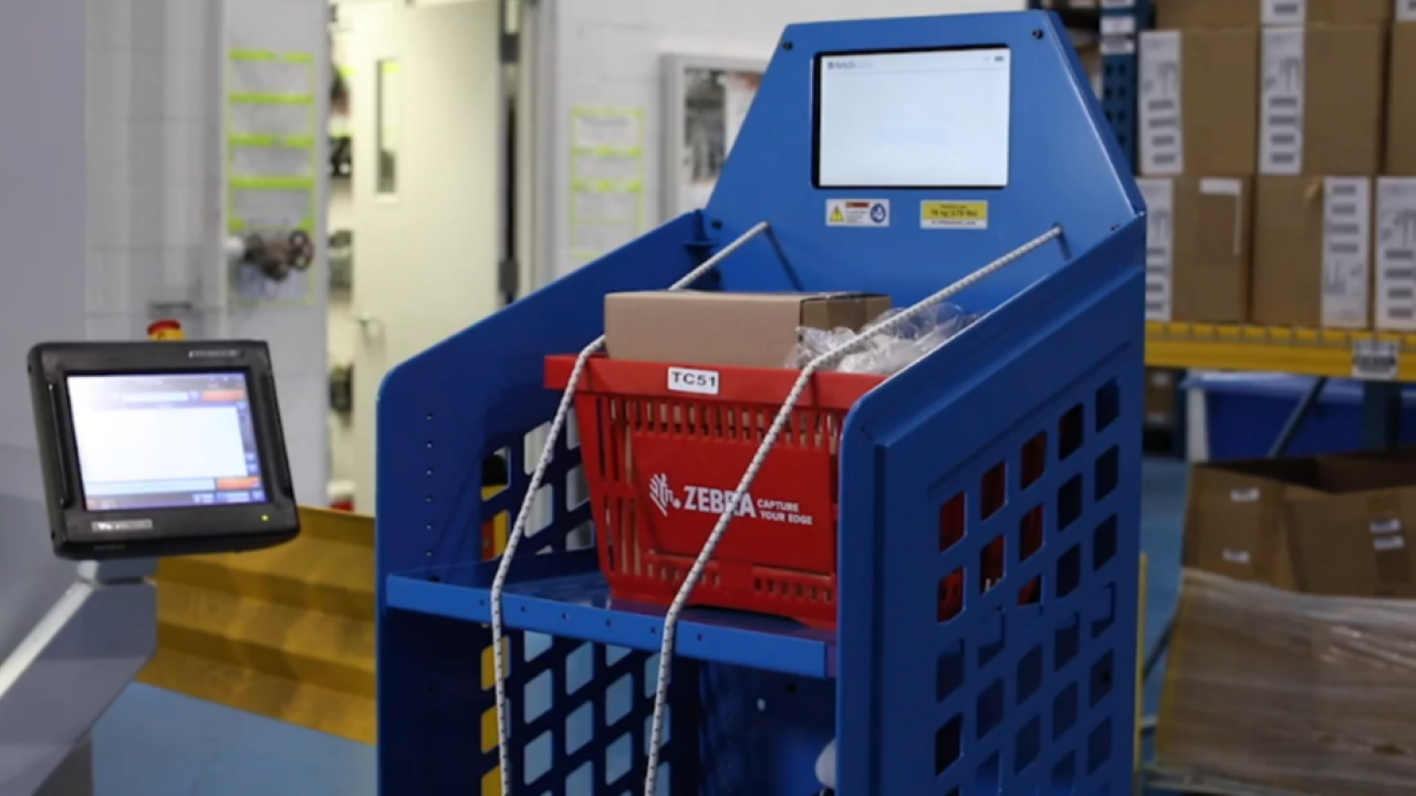 A Fetch Robotics cart helps with picking in a warehouse