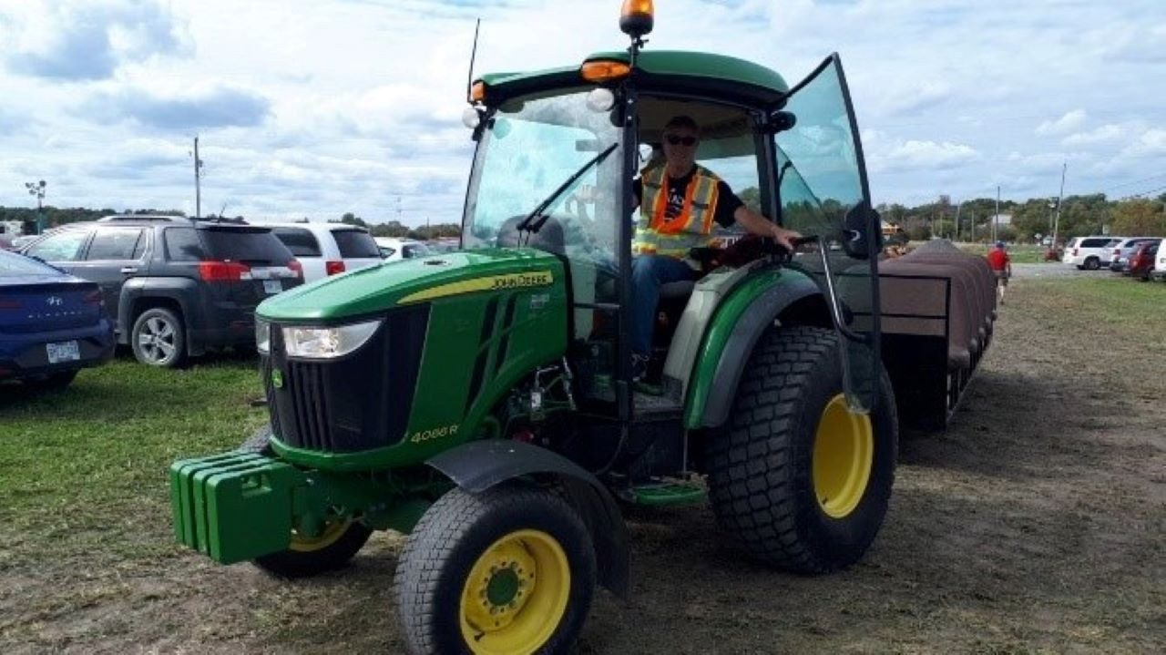 Scott Murchison drives a tractor at the local fair