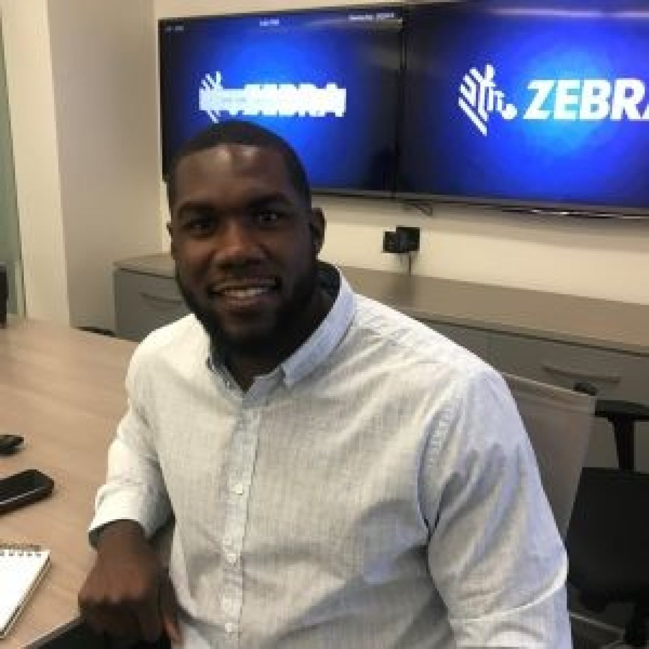 NFL defensive lineman Eric Lee smiles during his Zebra externship