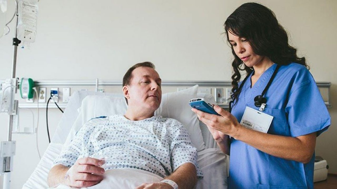 Nurse using Zebra product to check on patient