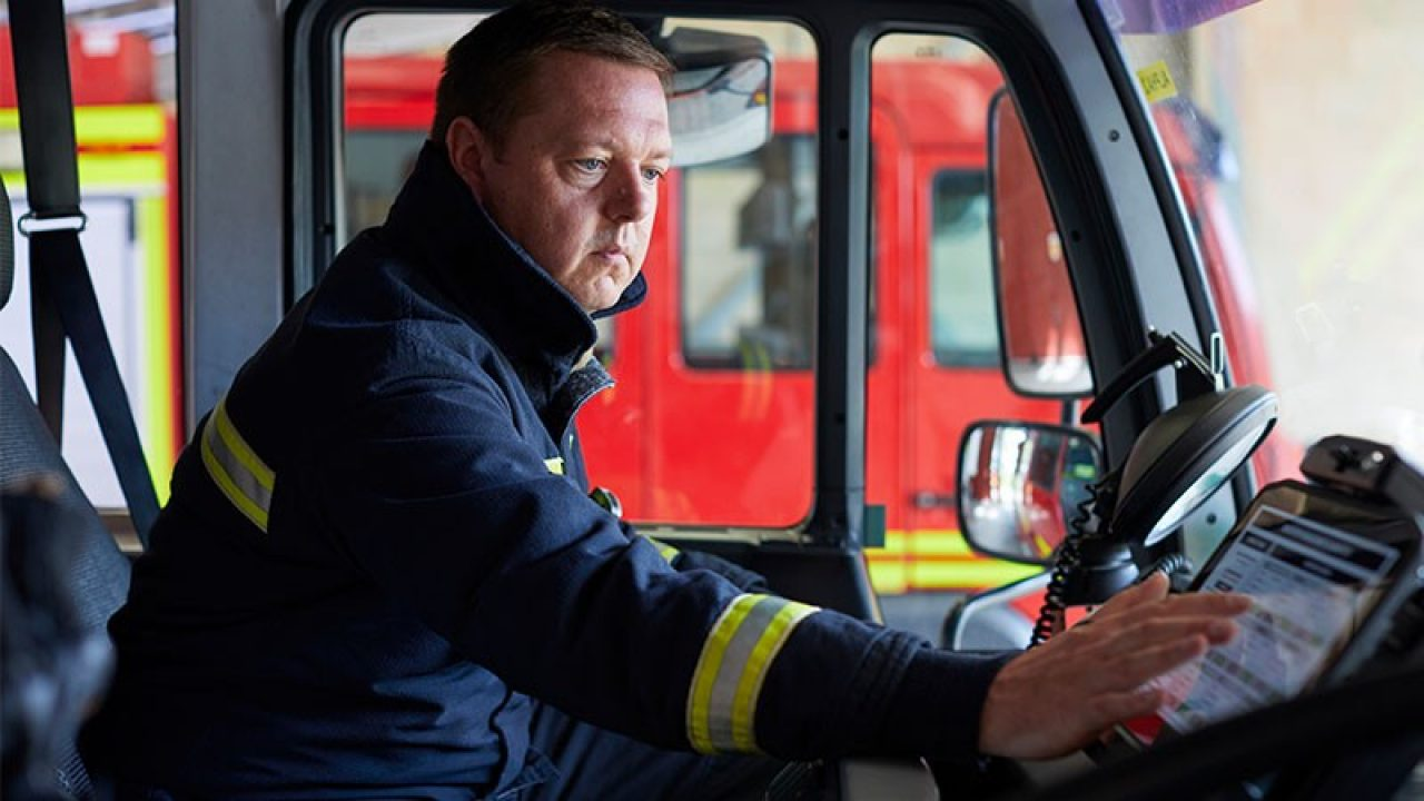 Firefighter working on a tablet in a fire truck