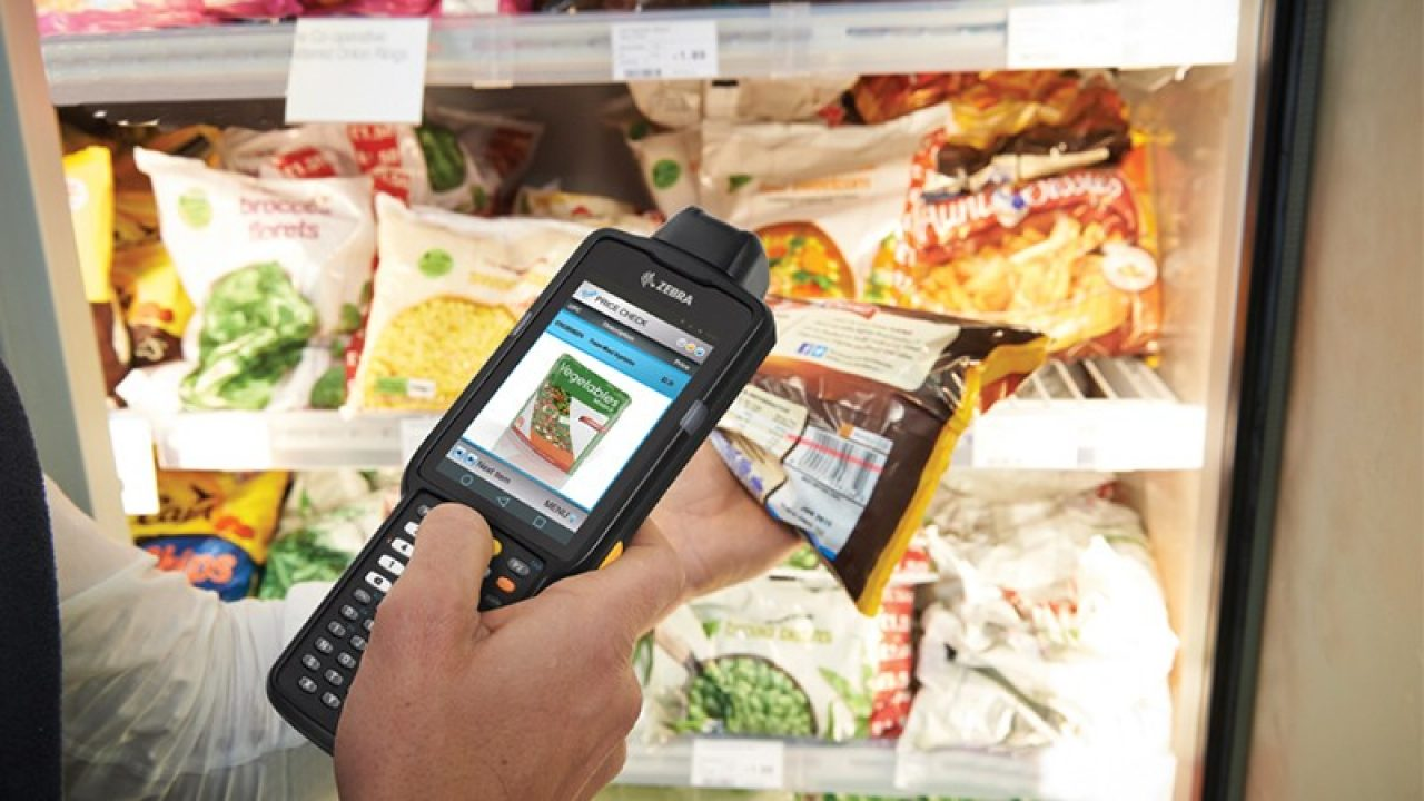 Barcode being scanned on a bag of frozen food