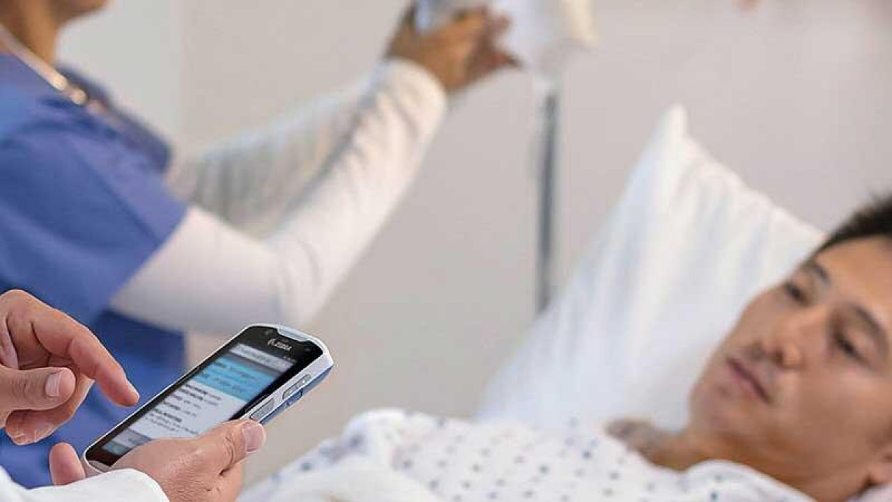 Healthcare provider scanning patient with mobile device for healthcare mobility