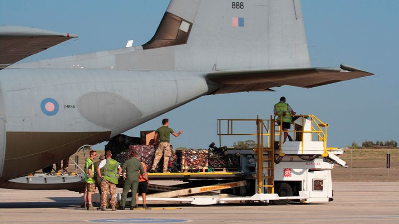 UK Military airplane being loaded with cargo