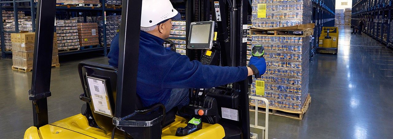 Worker in warehouse using the LI3608\u002DER barcode scanner.