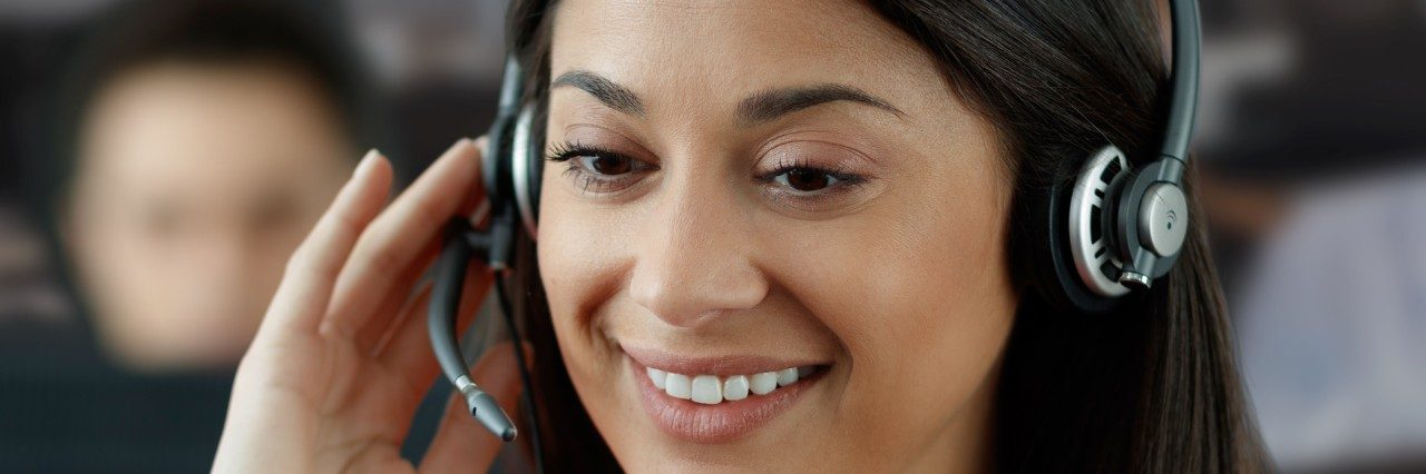 Woman answering the phone with a headset