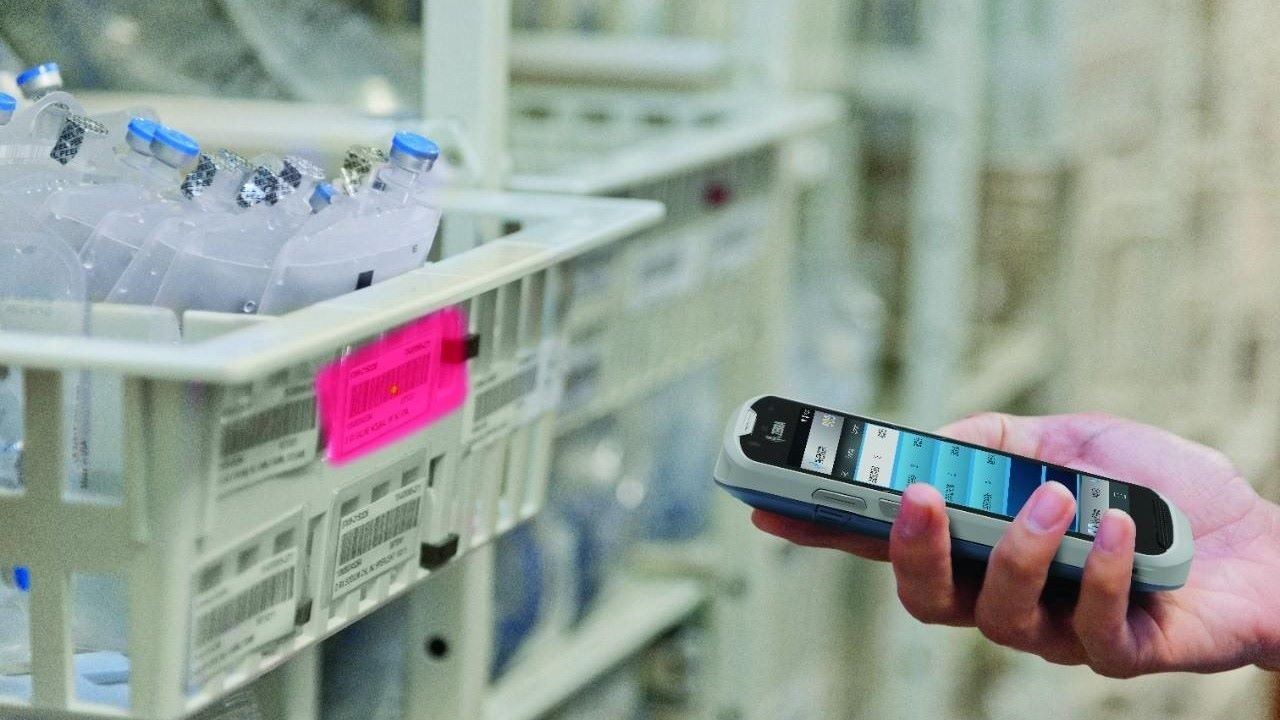 A Zebra TC52\u002DHC clinical smartphone is use to scan specimen collection tubes during an inventory count.
