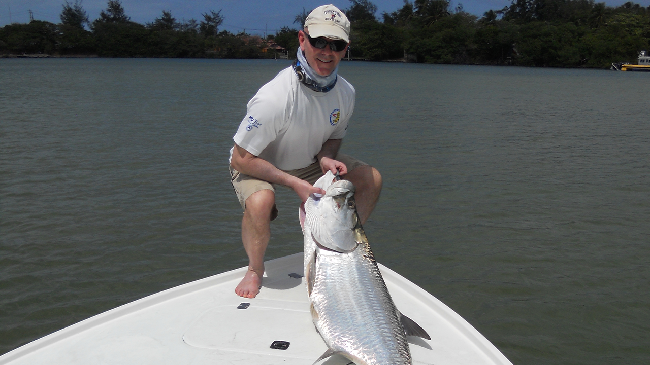 Zebra's Senior Director and Corporate Counsel Todd Beck shows off a fish he caught on a recent expedition in Puerto Rico.