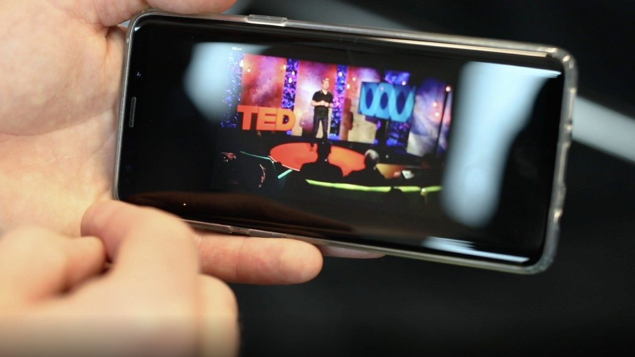 Someone watches James Morley\u002DSmith`s TED Talk on a smartphone