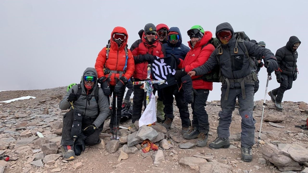 The full team at the top of Mount Aconcagua, including Zebra`s \x26#34;Three Amigos\x26#34;