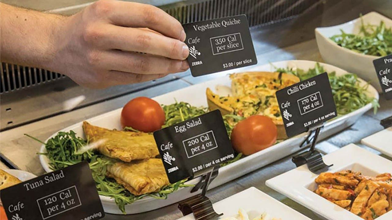 A buffet with food safety cards