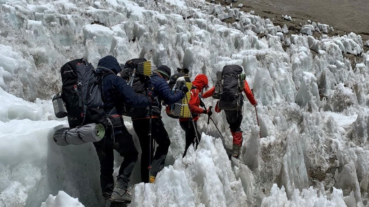 The Three Amigos make their way through ice as they continue their ascent up Mount Aconcagua alongside their guide.