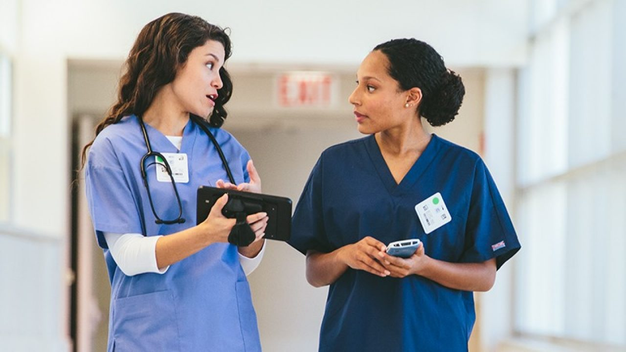 Two healthcare workers having a discussion