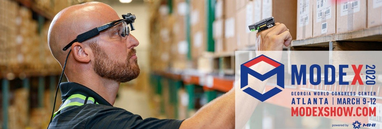 Man in warehouse using wearable computing technology