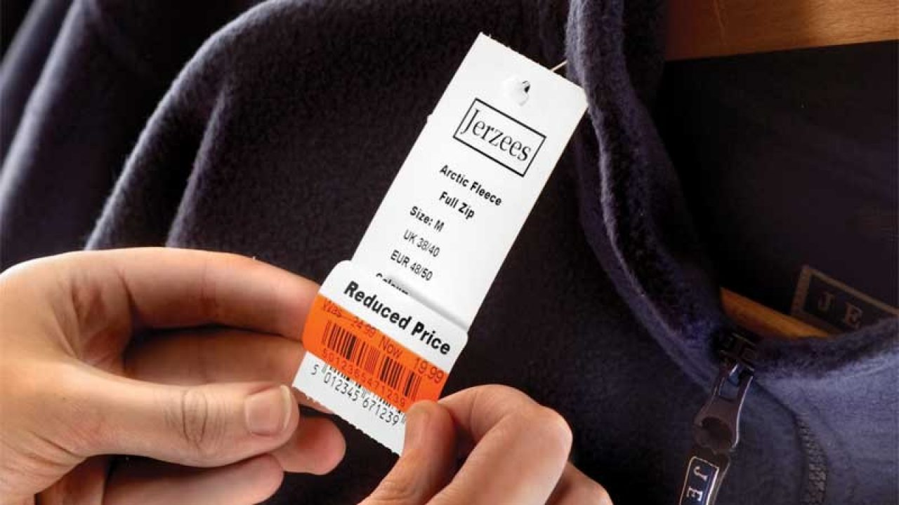 Placing a Zebra tag on a jacket price tag