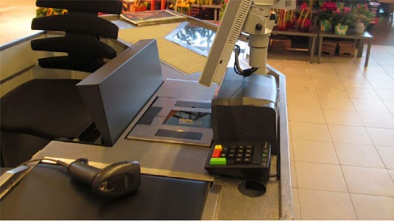 a Fenberg Supermarket checkout lane with a Zebra multiplane scanner